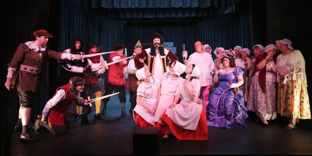 Highbury performers on stage wielding swords