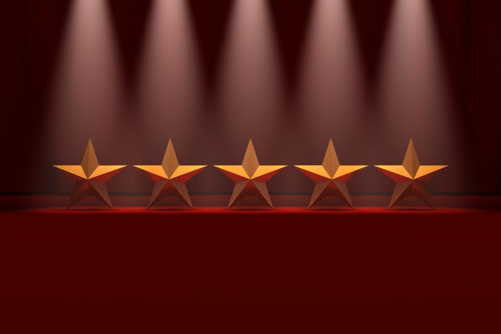 Theatre reviews image shows five performing gold stars on a stage!
